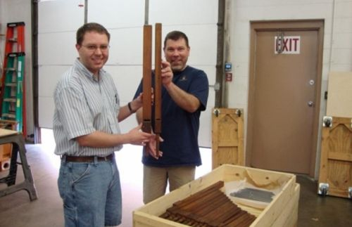 David Grandall (left) and office manager Andrew Fredel displaying some pipes in the shop